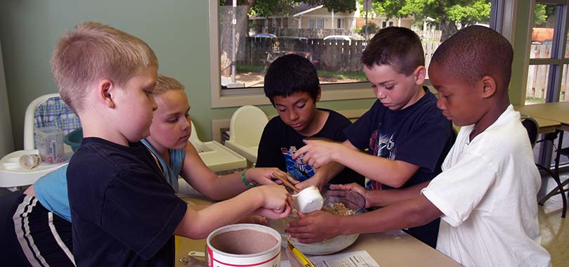 kids learning to bake